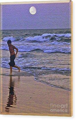 A Boy's Beach Run Wood Print by Lydia Holly