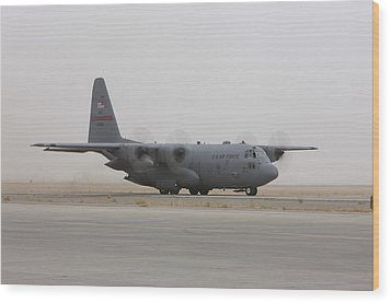 A C-130 Hercules Aircraft Taxis Wood Print by Terry Moore