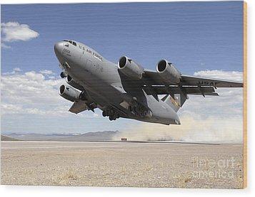 A C-17 Globemaster Departs Wood Print by Stocktrek Images