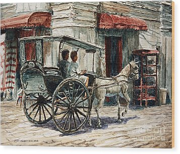 A Carriage On Crisologo Street Wood Print by Joey Agbayani