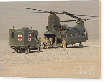 A Ch-47 Chinook Helicopter Drops Wood Print by Andrew Chittock