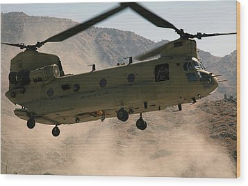 A Ch-47 Chinook Helicopter Kicks Wood Print by Stocktrek Images