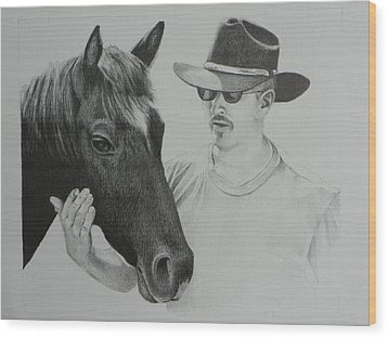A Cowboy And His Horse Wood Print by David Ackerson