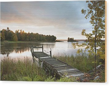 A Dock On A Lake At Sunrise Near Wawa Wood Print by Susan Dykstra