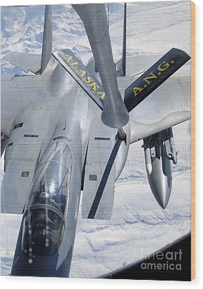 A F-15 Eagle Refuels Behind A Kc-135 Wood Print by Stocktrek Images