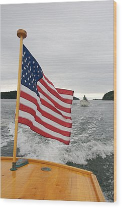 A Flag Waves On The Stern Of A Maine Wood Print by Heather Perry