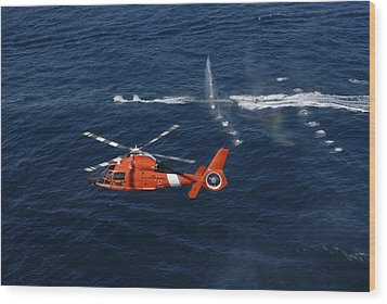 A Helicopter Crew Trains Off The Coast Wood Print by Stocktrek Images
