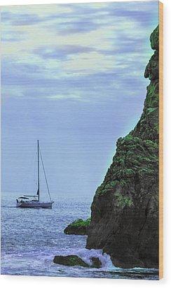 A Lone Sailboat Floats On A Calm Sea Wood Print