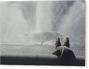 A Man Relaxes At A Fountain Wood Print by Stacy Gold