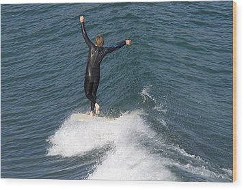 A Man Surfs A Longboard At Refugio Wood Print by Rich Reid