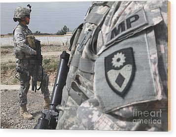 A Military Police Officer Provides Wood Print by Stocktrek Images