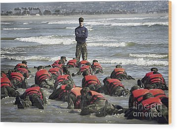 A Navy Seal Instructor Assists Students Wood Print by Stocktrek Images