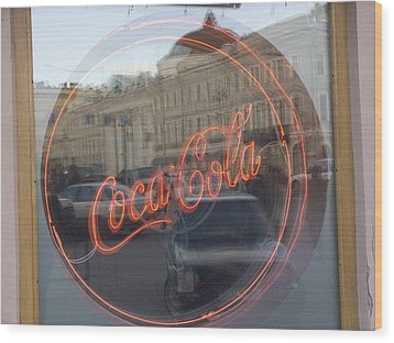 A Neon Coca Cola Sign Is Displayed Wood Print by Richard Nowitz