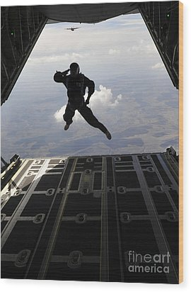 A Paratrooper Salutes As He Jumps Wood Print by Stocktrek Images
