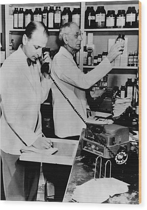 A Pharmacist Demonstrates The Use Of An Wood Print by Everett