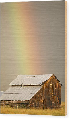 A Rainbow Arches From The Sky Onto Wood Print by Michael S. Lewis
