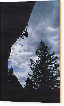 A Rock Climber Ascends A Steep Route Wood Print by Bill Hatcher