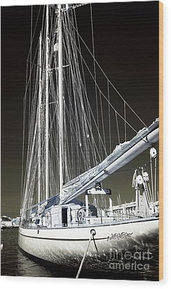 A Sailboat In Marseille Wood Print by John Rizzuto