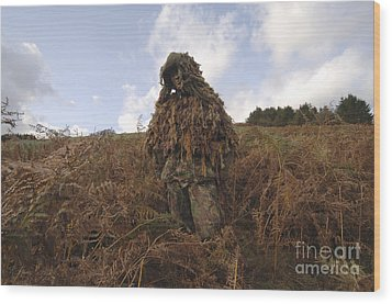 A Sniper Dressed In A Ghillie Suit Wood Print by Andrew Chittock