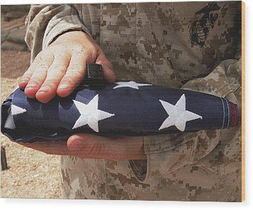 A Soldier Holds The United States Flag Wood Print by Stocktrek Images