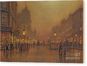 A Street At Night Wood Print by John Atkinson Grimshaw
