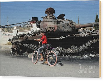 A Syrian Boy On His Bicycle In Front Wood Print by Andrew Chittock