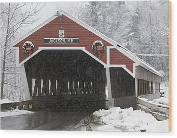 A Traditional Covered Bridge On A Snowy Wood Print by Tim Laman