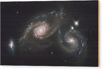 A Triplet Of Galaxies Known As Arp 274 Wood Print by Stocktrek Images