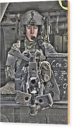 A Uh-60 Black Hawk Door Gunner Manning Wood Print by Terry Moore