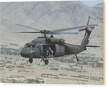 A Uh-60 Blackhawk Helicopter Wood Print by Stocktrek Images