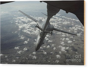 A U.s. Air Force Kc-10 Refuels A B-1b Wood Print by Stocktrek Images