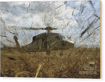 A U.s. Navy Hh-60 Seahawk Stirs Wood Print by Stocktrek Images