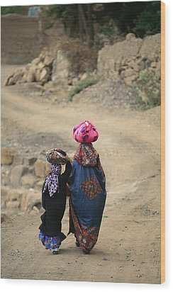 A Yemeni Woman And Child Carrying Wood Print by Michael Melford