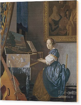 A Young Lady Seated At A Virginal Wood Print by Jan Vermeer