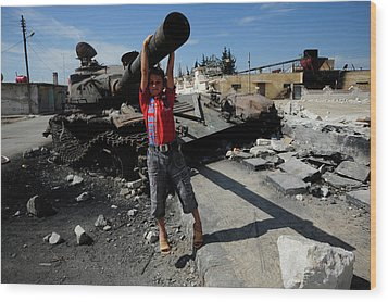 A Young Syrian Boy Plays On The Turret Wood Print by Andrew Chittock