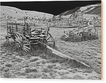 Abandoned Wagons Of Bannack Montana Ghost Town Wood Print by Daniel Hagerman