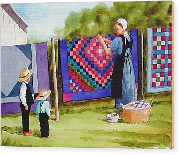 Airing The Quilts Wood Print by Faye Ziegler