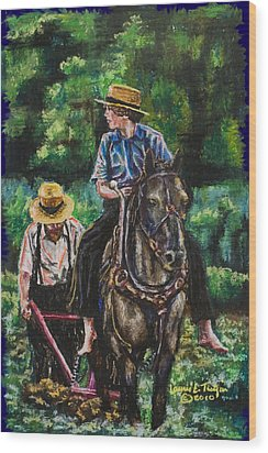 Amish Plowing Wood Print by Laurie Tietjen