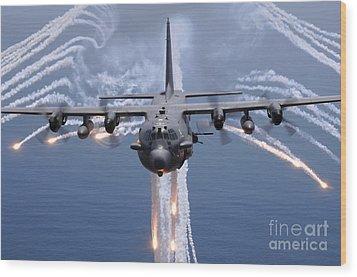 An Ac-130h Gunship Aircraft Jettisons Wood Print by Stocktrek Images
