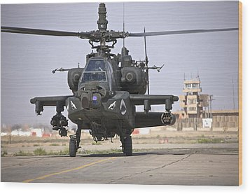 An Ah-64 Apache Helicopter Returns Wood Print by Terry Moore