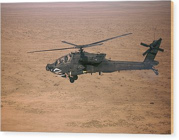 An Ah-64d Apache Longbow Fires A Hydra Wood Print by Terry Moore