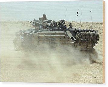 An Amphibious Assault Vehicle Kicks Wood Print by Stocktrek Images