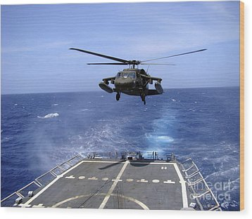 An Army Uh-60 Black Hawk Helicopter Wood Print by Stocktrek Images