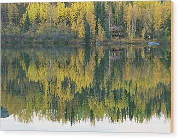 An Autumn View Of A Cabin Reflected Wood Print by Rich Reid