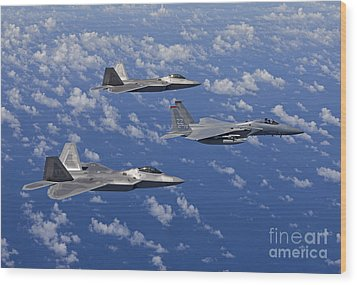 An F-15 Eagle And Two F-22 Raptors Fly Wood Print by HIGH-G Productions