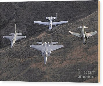 An F-16 Fighting Falcon, F-15 Eagle Wood Print by Stocktrek Images