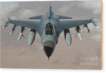 An F-16 Fighting Falcon Flies A Mission Wood Print by Stocktrek Images