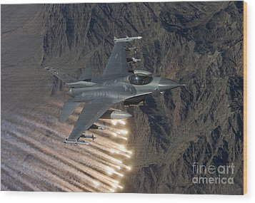 An F-16 Fighting Falcon Releases Flares Wood Print by HIGH-G Productions