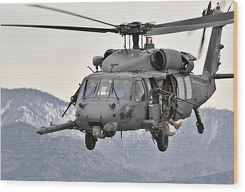 An Hh-60 Pave Hawk Helicopter In Flight Wood Print by Stocktrek Images