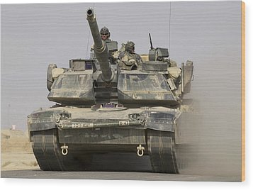 An M1a1 Abrams Tank Heading Wood Print by Stocktrek Images